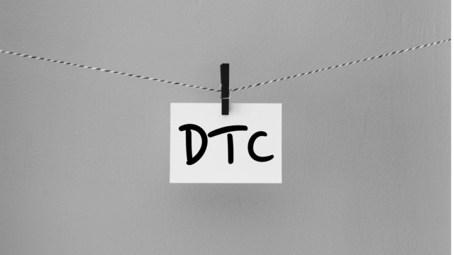 "Photo of a close line with a piece of paper that says ""DTC"" pinned to it."